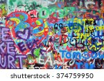 A Wall Sprayed With Colorful...