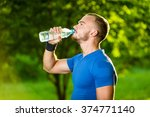 athletic mature man drinking... | Shutterstock . vector #374771140