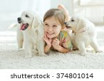 Stock photo the child with the dog lying on the mat at home 374801014