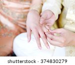 he put the wedding ring on her  | Shutterstock . vector #374830279