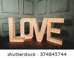 Love Letter With Light Bulb In...