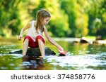 cute little girl playing with... | Shutterstock . vector #374858776