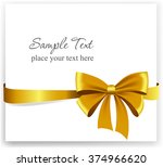 gold gift bow with ribbons.... | Shutterstock .eps vector #374966620