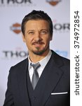 """Small photo of LOS ANGELES, CA - NOVEMBER 4, 2013: Jeremy Renner at the US premiere of """"Thor: The Dark World"""" at the El Capitan Theatre, Hollywood. Picture: Paul Smith / Featureflash"""