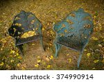 chairs with autumn leaves | Shutterstock . vector #374990914