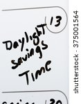 Small photo of March 13th on a calendar marked with daylight savings time with aback marker