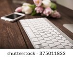 keyboard  phone  and pink tulips | Shutterstock . vector #375011833