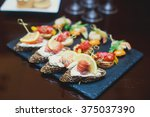 beautifully decorated catering... | Shutterstock . vector #375037390