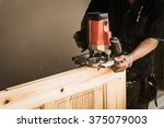 hands of carpenter with... | Shutterstock . vector #375079003