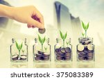 hand putting money coins and... | Shutterstock . vector #375083389