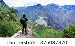 tourist looking over machu... | Shutterstock . vector #375087370