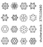 set of black snowflakes on a... | Shutterstock .eps vector #375110680