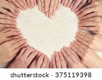a lot of fingers making heart...