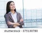 attractive woman in office... | Shutterstock . vector #375130780