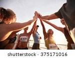 runners high fiving each other... | Shutterstock . vector #375171016