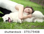 beautiful woman playing with dog | Shutterstock . vector #375175408