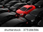 Stock photo red car surrounded by black cars 375186586