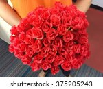 Stock photo red roses in hand 375205243