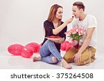 young couple sitting on the... | Shutterstock . vector #375264508