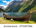 Old viking boat replica in a norwegian landscape near Flam, Norway. - stock photo