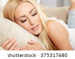 attractive young woman lying... | Shutterstock . vector #375317680