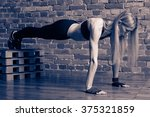 fitness woman performing planck ... | Shutterstock . vector #375321859