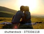 cuddling couple. couple in love.... | Shutterstock . vector #375336118