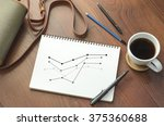a cup of coffee and business... | Shutterstock . vector #375360688