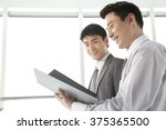 two businessmen working together | Shutterstock . vector #375365500