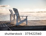 muskoka chairs on a dock over... | Shutterstock . vector #375422560