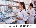 smiling pharmacist and indian... | Shutterstock . vector #375459526