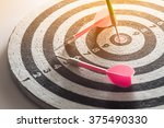 dart arrow hitting in the... | Shutterstock . vector #375490330