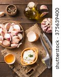Small photo of Portion of homemade Aioli dip in small bowl on wooden background