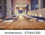 empty brown wooden table and... | Shutterstock . vector #375661330