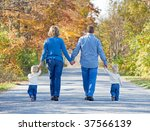 family taking a walk in the... | Shutterstock . vector #37566139