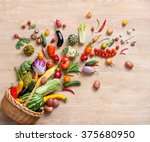 Small photo of Healthy food background / studio photography of different fruits and vegetables on wooden table