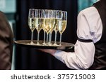waiter with champagne | Shutterstock . vector #375715003