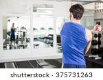 handsome man doing stretching... | Shutterstock . vector #375731263