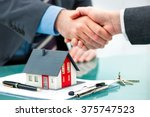 estate agent shaking hands with ... | Shutterstock . vector #375747523