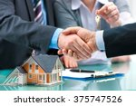 estate agent shaking hands with ... | Shutterstock . vector #375747526