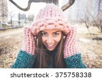 a beautiful woman in a knit... | Shutterstock . vector #375758338