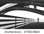man walking outdoor under bridge | Shutterstock . vector #375814864