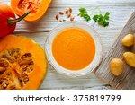 pumpkin soup cream on a wooden... | Shutterstock . vector #375819799