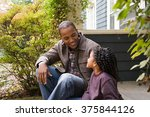 father and daughter outside... | Shutterstock . vector #375844126