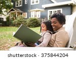 mother and daughter with book | Shutterstock . vector #375844204