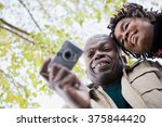 the couple using a camera   Shutterstock . vector #375844420