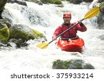 whitewater kayaker in a creek | Shutterstock . vector #375933214