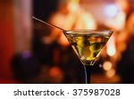 glass with martini   focus on a ... | Shutterstock . vector #375987028