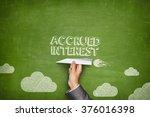 Small photo of Accrued interest concept on blackboard with paper plane