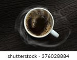 black coffee cup on old wood... | Shutterstock . vector #376028884